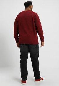 BAD RHINO - PLUS - Slim fit jeans - black - 2