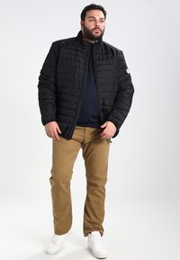 BAD RHINO - PADDED PANEL - Light jacket - black - 1