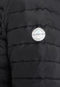 BAD RHINO - PADDED PANEL - Light jacket - black - 4