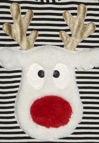 WAUW CAPOW by Bangbang Copenhagen - DEAR DEER BABY CHRISTMAS - Body - black /white - 4