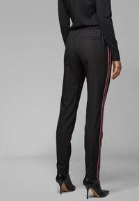 BOSS - TAHWA - Trousers - black - 2