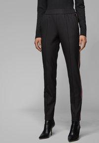 BOSS - TAHWA - Trousers - black - 0