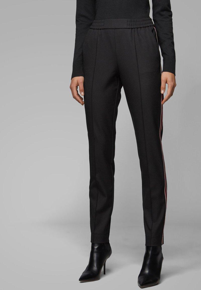BOSS - TAHWA - Trousers - black