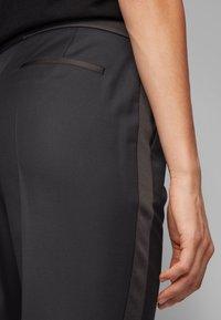 BOSS - TAXTINY - Trousers - black - 3