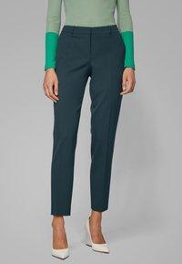 BOSS - TILUNA - Trousers - dark green - 0