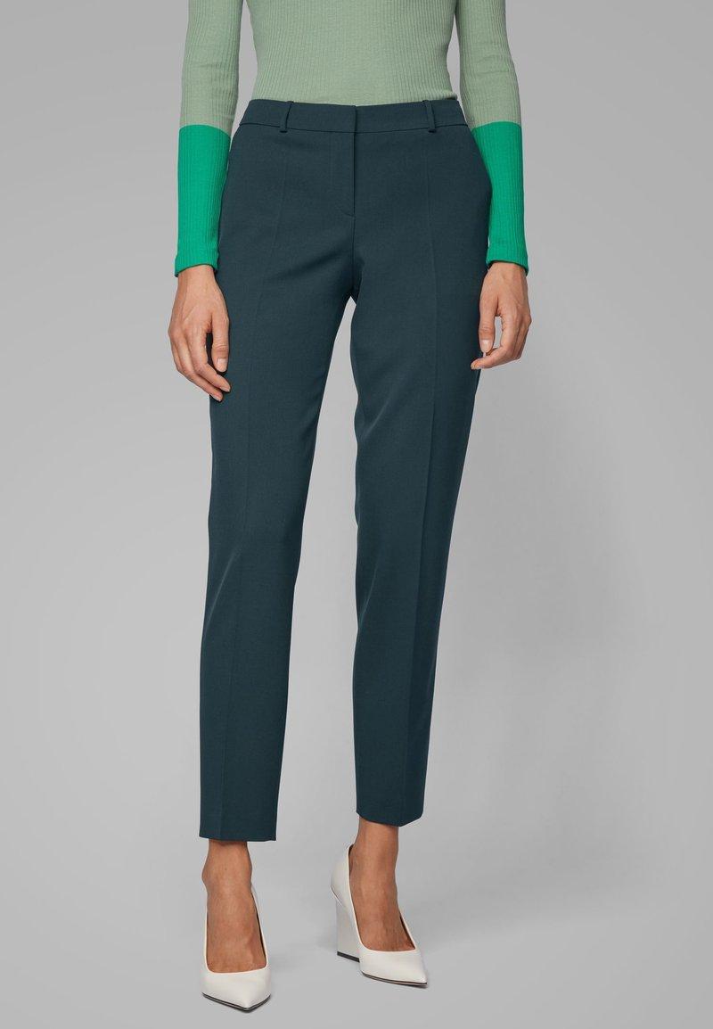 BOSS - TILUNA - Trousers - dark green