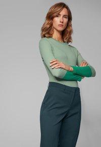 BOSS - TILUNA - Trousers - dark green - 3