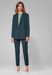 BOSS - TILUNA - Trousers - dark green - 1