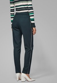 BOSS - TAHWANI - Tracksuit bottoms - dark green - 2