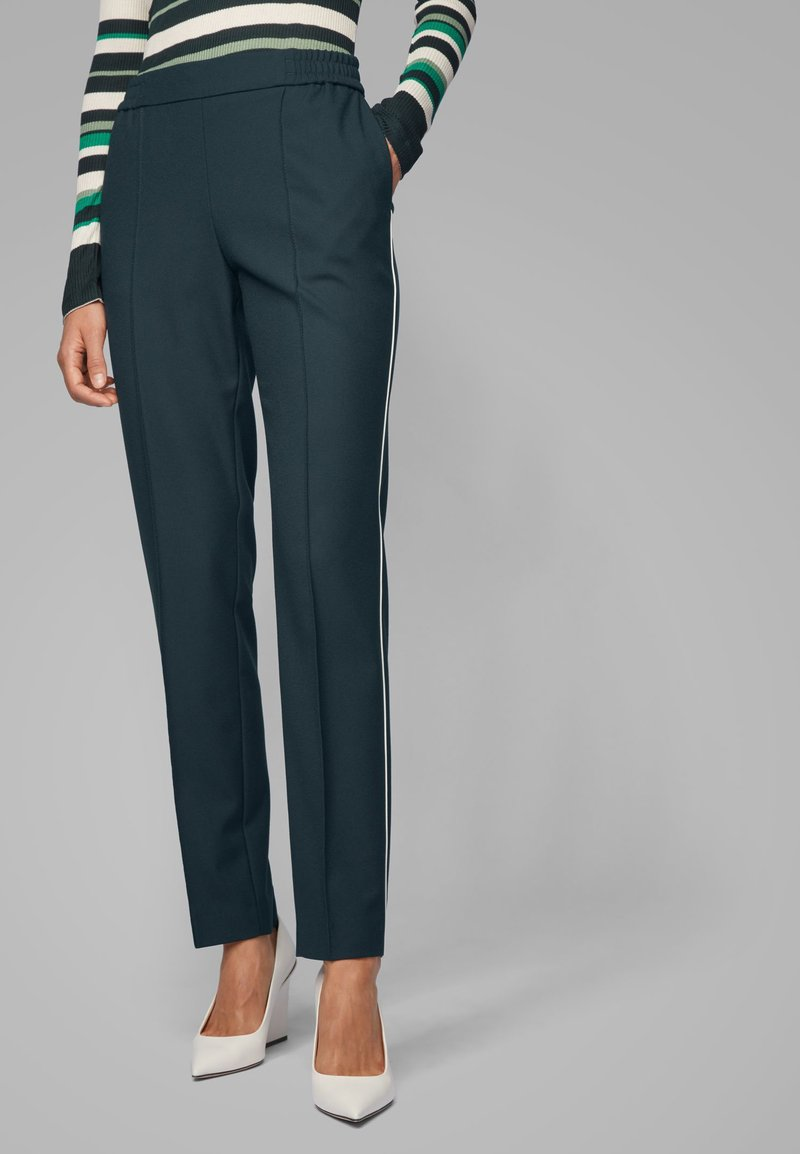 BOSS - TAHWANI - Tracksuit bottoms - dark green
