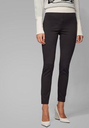 TELESTANA - Trousers - black
