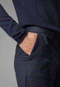 BOSS - TITANA - Trousers - dark blue - 3