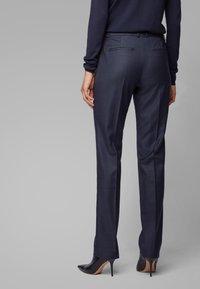 BOSS - TITANA - Trousers - dark blue - 2
