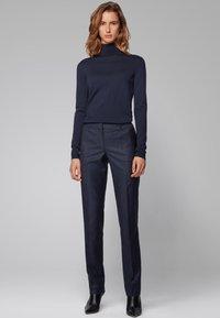 BOSS - TITANA - Trousers - dark blue - 1