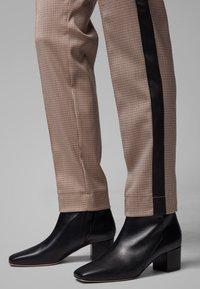 BOSS - TAHWA - Trousers - beige - 3