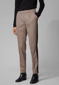 BOSS - TAHWA - Trousers - beige - 0