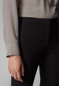 BOSS - TILUNI1 - Trousers - black - 3