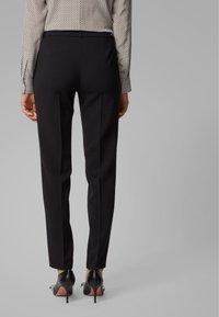 BOSS - TILUNI1 - Trousers - black - 2
