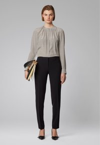 BOSS - TILUNI1 - Trousers - black - 1