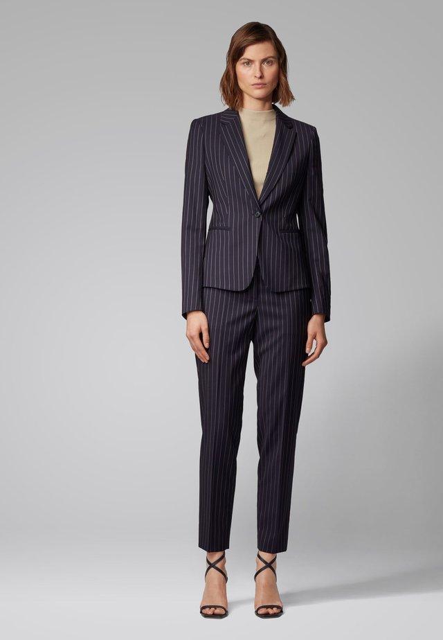 TILUNA11 - Pantalon classique - patterned
