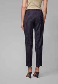 BOSS - TILUNA11 - Trousers - patterned - 2