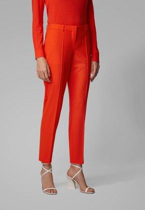 TILUNA11 - Trousers - orange