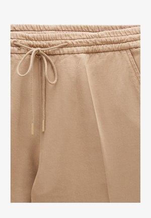 SATENCY2-D - Tracksuit bottoms - beige