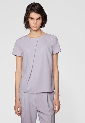 IVUNI - T-shirt con stampa - light purple