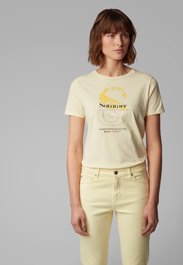 TENOVEL - Print T-shirt - light yellow