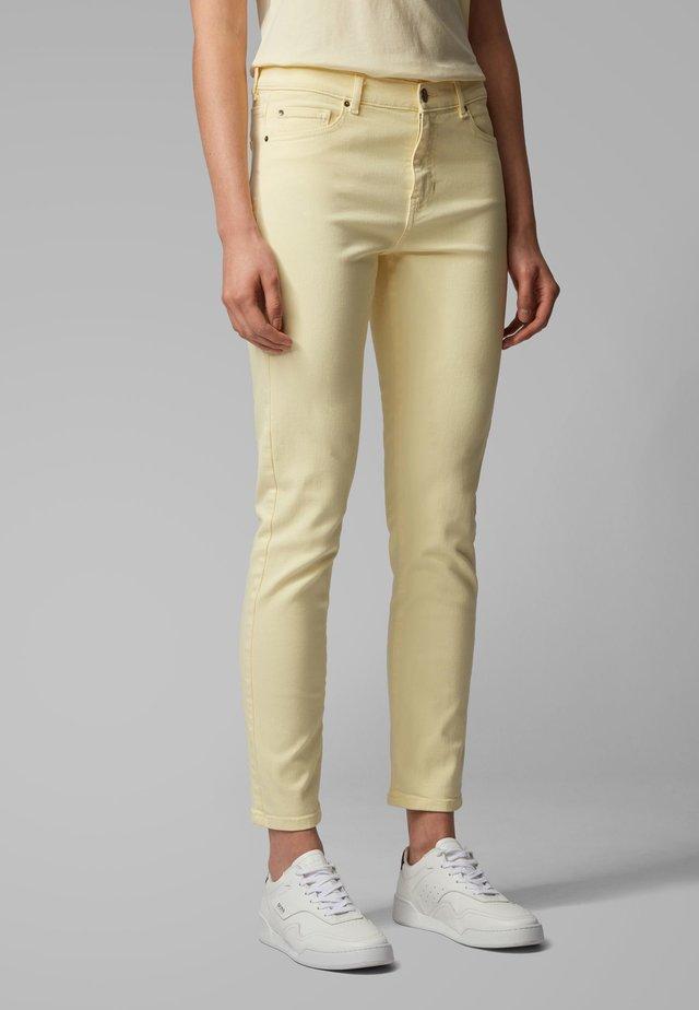 J21 SELMA - Slim fit jeans - light yellow