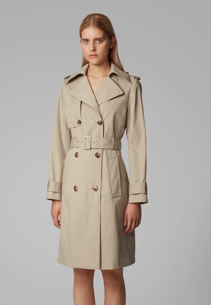 BOSS - CANDROMEDAE - Trenchcoats - beige
