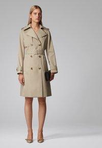 BOSS - CANDROMEDAE - Trenchcoats - beige - 1
