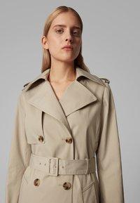 BOSS - CANDROMEDAE - Trenchcoat - beige - 3