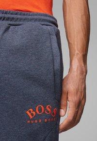 BOSS - HADIKO - Tracksuit bottoms - blue - 3