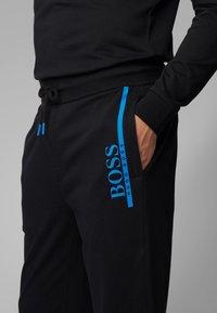 BOSS - Tracksuit bottoms - black - 3