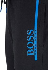 BOSS - Tracksuit bottoms - black - 4