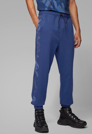SUPERSONIC - Tracksuit bottoms - dark blue
