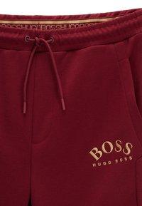 BOSS - HADIKO - Trainingsbroek - dark pink - 4