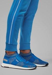 BOSS - HADIKO - Tracksuit bottoms - blue - 2