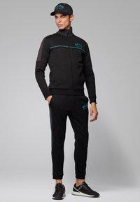 BOSS - HADIKO - Pantaloni sportivi - black - 1