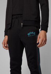 BOSS - HADIKO - Pantaloni sportivi - black - 3