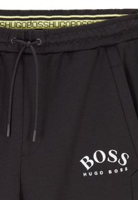 BOSS - HADIKO - Tracksuit bottoms - black - 3