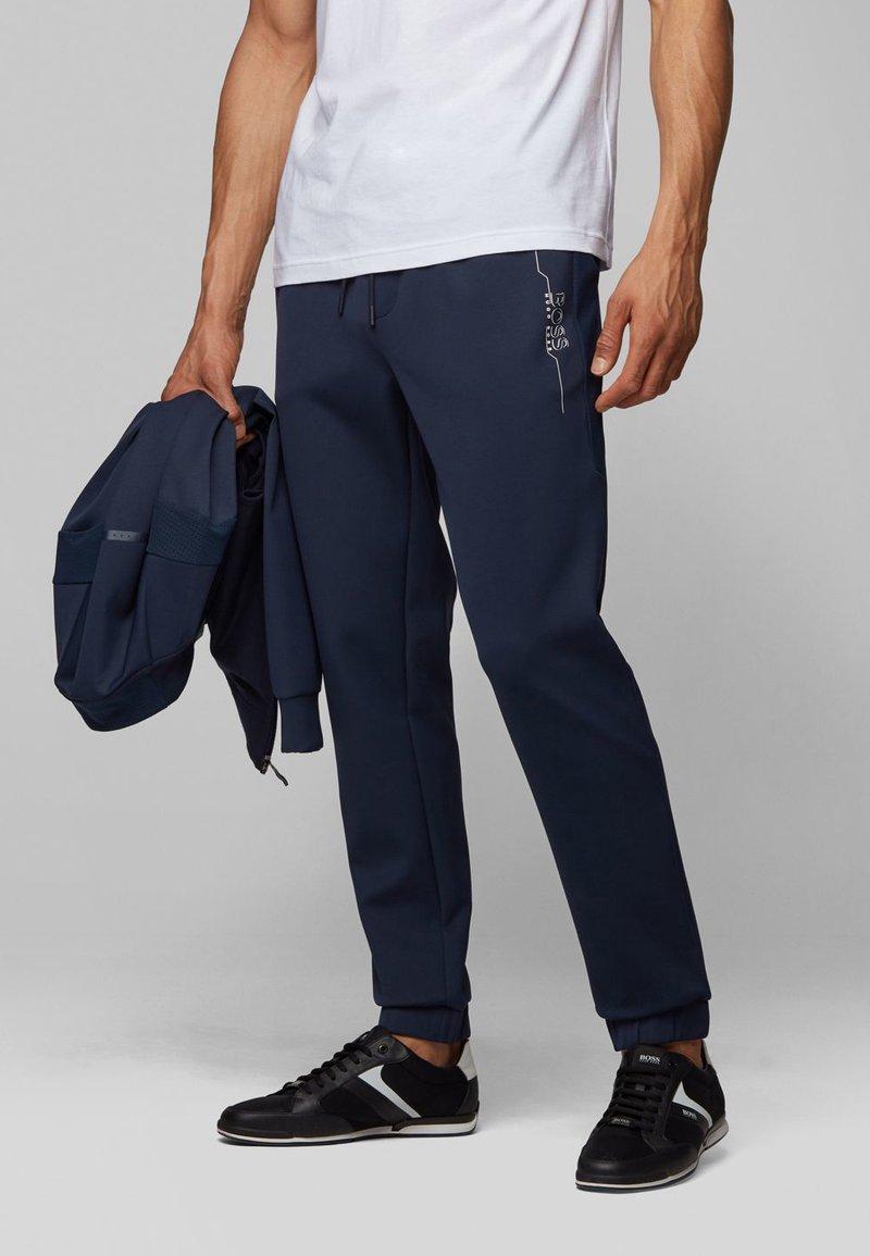 BOSS - HICON - Tracksuit bottoms - dark blue