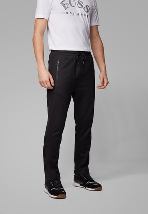 HURLEY - Tracksuit bottoms - black