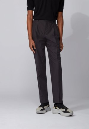 PIETER - Trousers - black