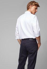 BOSS - MAINE - Straight leg jeans - dark blue - 3