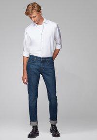 BOSS - DELAWARE - Straight leg jeans - dark blue - 1