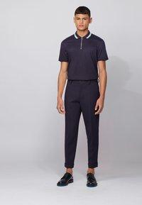 BOSS - PARAS 06 - Polo shirt - dark blue - 0