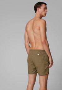BOSS - OCTOPUS - Swimming shorts - dark brown - 1