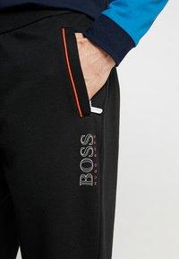 BOSS - Träningsbyxor - black - 5